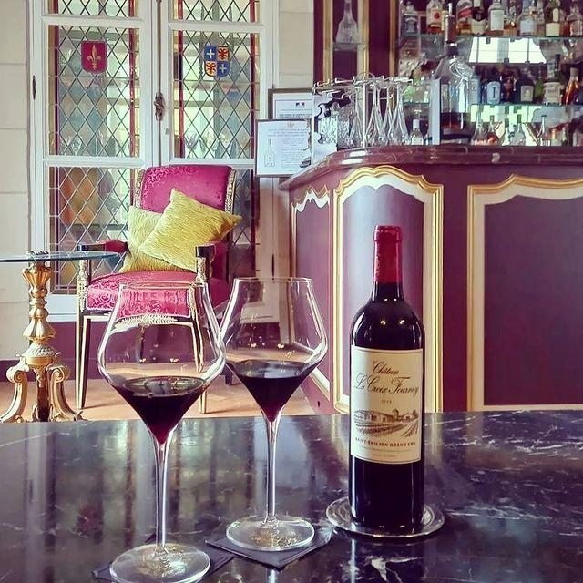 Enjoying a bottle of Bordeaux in Beauvois' Louis XIII Bar. 🍷