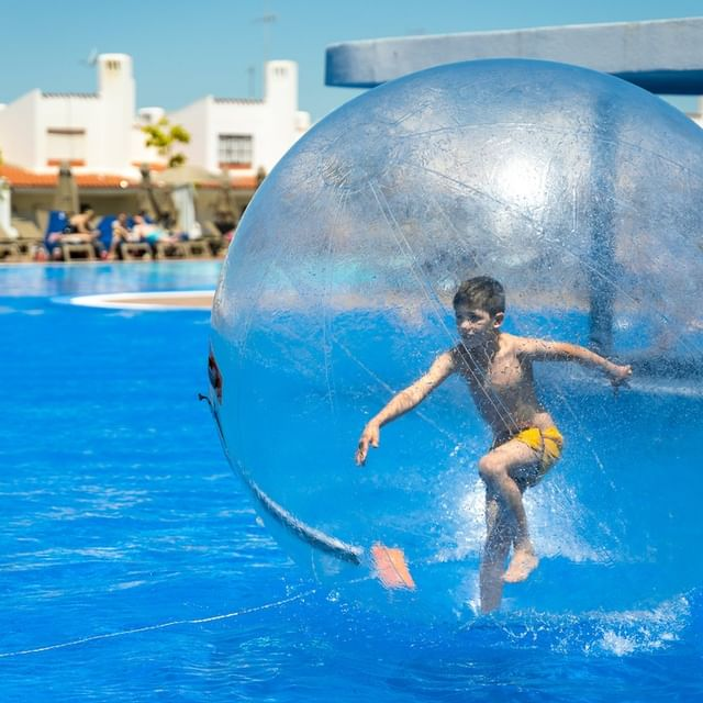 The fun just keeps on rolling 😎 Roll around the pool inside a giant water ball!