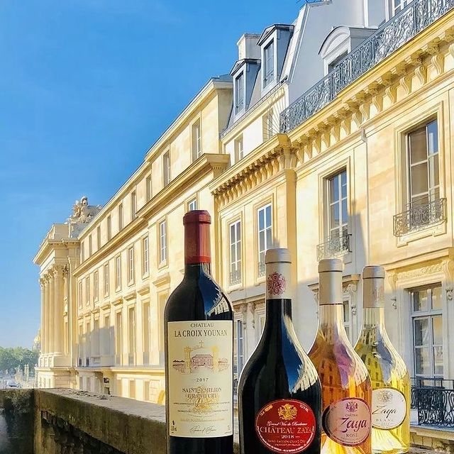 Which @Vignobles.Younan bottle of wine should we open today with our afternoon view of Paris? Our 2017 vintage of @ChateauLaCroixYounan Bordeaux, or a bottle of Bordeaux, Blanc or Rosé from the @ChateauZaya Trilogy? 🍷